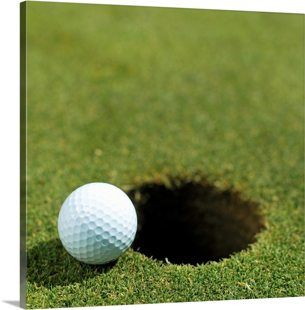 Golf ball on the edge of the hole Wall Art, Canvas Prints ...