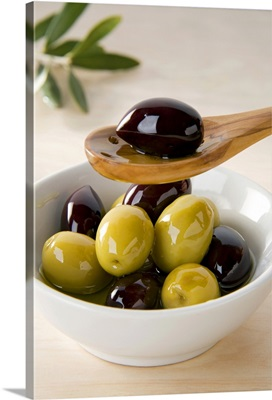 Green and black olives in bowl