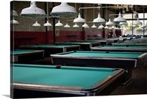 Group of pool tables in empty pool hall