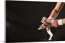 Gymnast chalking up hands