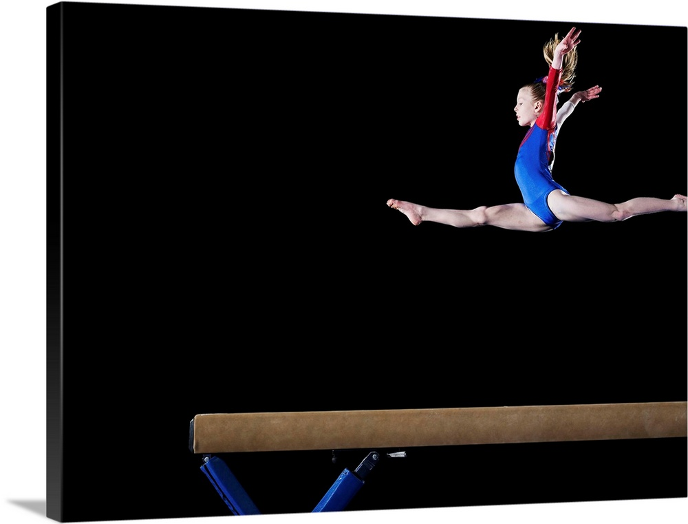 gymnast leaping on balance beam