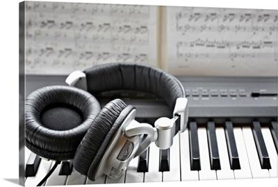 Headphones on electronic piano keyboard
