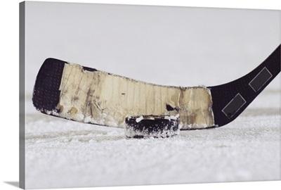 Ice hockey stick and puck, close-up
