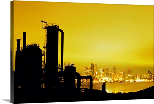 Industrial equipment silhouetted against a yellow sky, Seattle ...