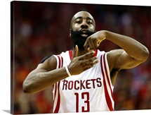 James Harden 13 of the Houston Rockets celebrates in the fourth quarter