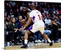 James Harden 13 of the Houston Rockets is guarded by Chris Paul