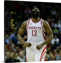 James Harden 13 of the Houston Rockets reacts after making a three-point shot