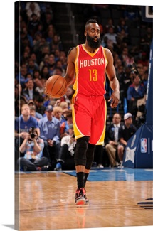 James Harden of the Houston Rockets brings the ball up court