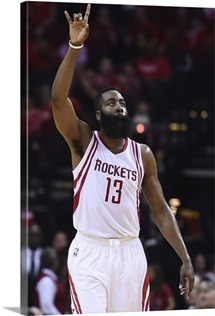 James Harden of the Houston Rockets reacts to a three point shot