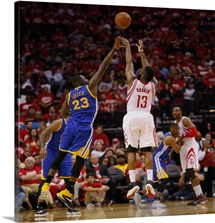 James Harden of the Houston Rockets shoots over Draymond Green