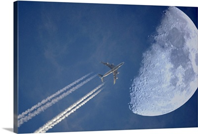 Jet in evening sky and moon, Germany.