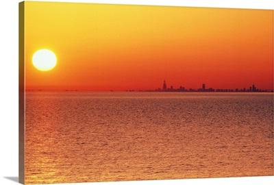 Lake Michigan under an orange sunset, Chicago side