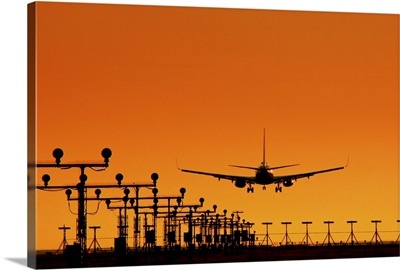 Landing of an airplane at sunset