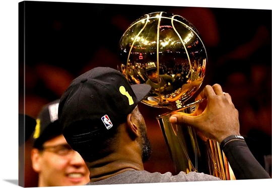 LeBron James Of The Cavaliers Holds Larry OBrien Championship Trophy