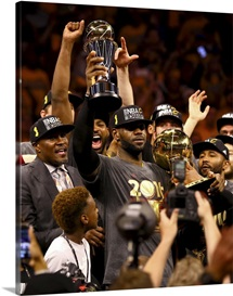 LeBron James of the Cavaliers holds the Larry O'Brien Championship Trophy