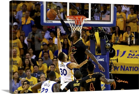 Lebron James Of The Cleveland Cavaliers Blocks A Shot By Stephen Curry Wall Art
