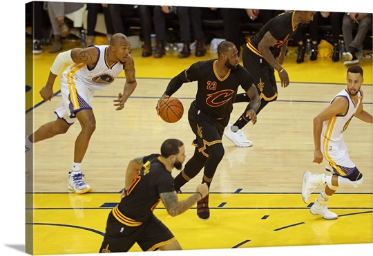 LeBron James of the Cleveland Cavaliers dribbles the ball up court ...