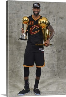 LeBron James of the Cleveland Cavaliers poses for a portrait with his MVP Trophy