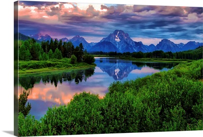 Light breaks through clouds over the Snake River at Oxbow Bend in Grand Tetons