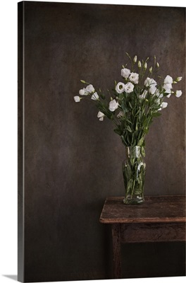 Lisianthus flowers in antique artisan blown vase in French house.