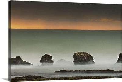 Long exposure of waves on seas rocks.