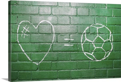 Love = Football drawn in chalk on wall.