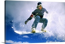 Low angle view of a young man snowboarding