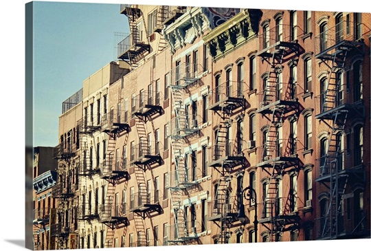 city building side. Lower east side cityscape of building fire escape stairs and windows  New York