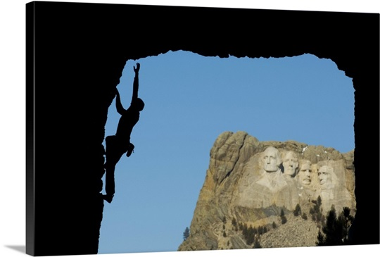 Man climbs near Mount Rushmore