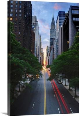 Manhattanhenge is when the sun sets exactly along the Manhattan cross-street grid.