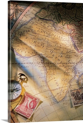 Map of Africa with compass and stamps