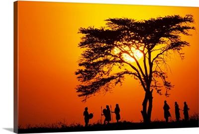Masai tribe silhouetted at dawn, Kenya