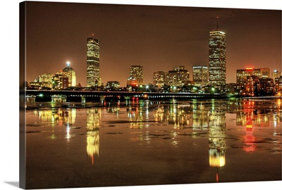 Massachusetts Avenue Bridge and Boston skyline, reflected in the Charles River at night