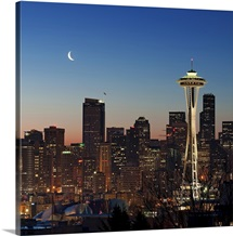 Moon rising over the iconic Space Needle, located in Seattle Washington, USA.