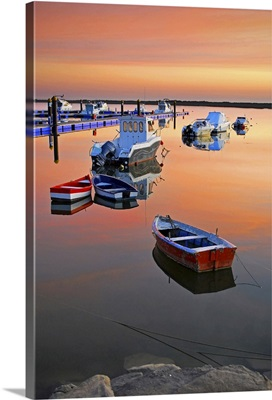 Moored boats on sea at sunset.