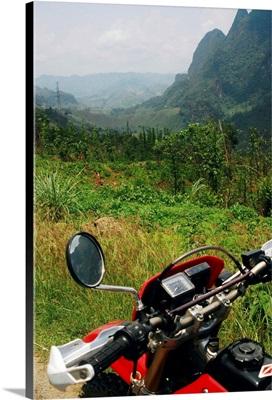 Motorbiking through mountains from Luang Prabang to Vang vieng, Laos, South East Asia.
