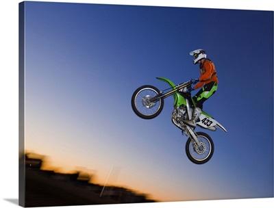 Motorcross rider jumping dirt bike