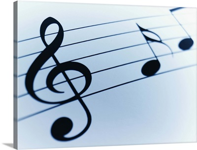 Music Sheet Detail with Bar and Treble Clef and Musical Notes