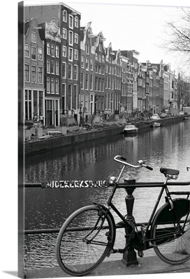 Netherlands, Amsterdam, bicycle parked by canal (B
