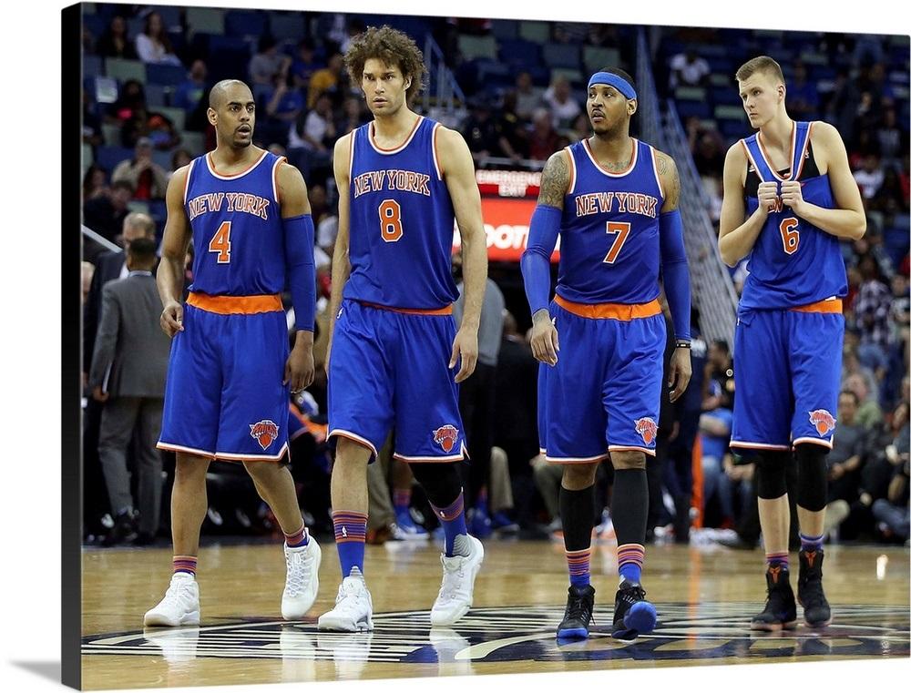 New York Knicks players walk onto the court