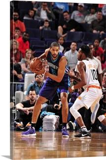 Nicolas Batum 5 of the Charlotte Hornets handles the ball against the Phoenix Suns