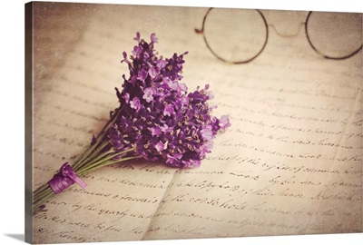 Old handwritten letter, pair of old fashioned round horn rimmed glasses and lavender.