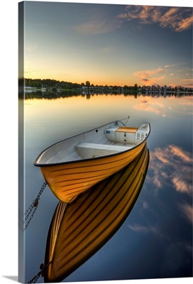 Orange boat with strong reflection sunset in Karlstad, Sweden.