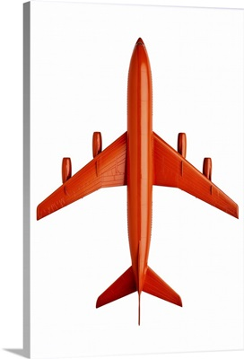 Orange plastic model of an airliner