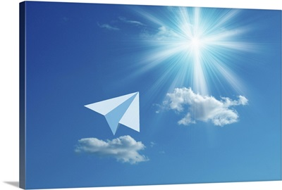 Paper airplane flying towards the sun