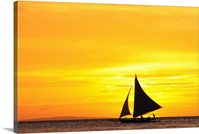 Paraw sailing at sunset, Philippines.