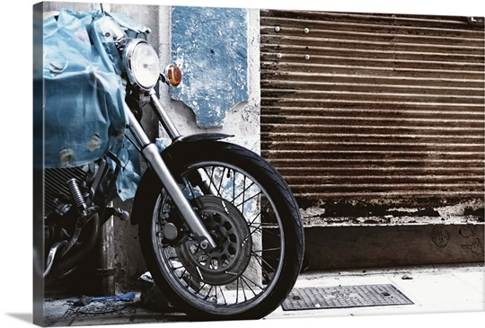 Parked Motorcycle With Rusty Garage Door Wall Art Canvas Prints