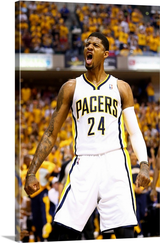 5af0c67e40b Paul George 24 of the Indiana Pacers celebrates after a play Wall ...