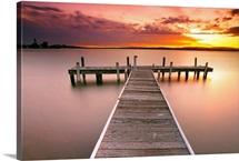 Pier in Lake Macquarie at sunset, Belmont, NSW, Australia.