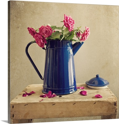 Pink roses and blue jug.